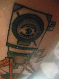 Man w/ a Movie Camera Tattoo